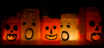 [stock photo of halloween faces on lighted bags]