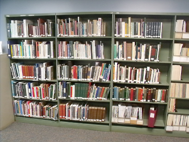 [photo: first three sections of shelving]