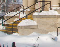 [photo of the library front steps with snow]